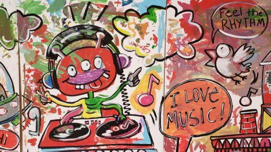 alien making music on a mural