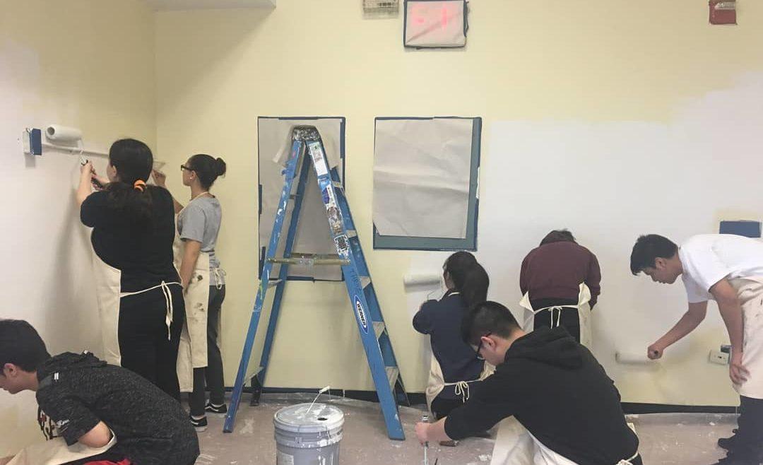 volunteers painting walls