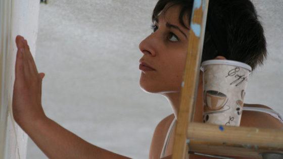 volunteer closely looking at detail