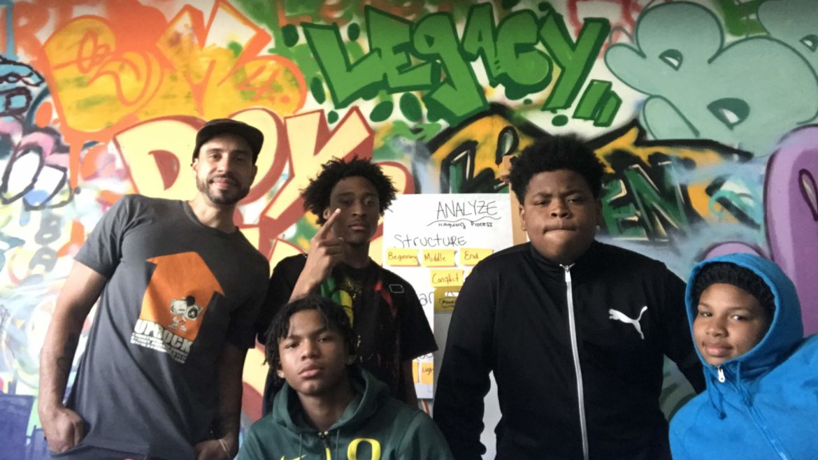 summer program students in front of mural