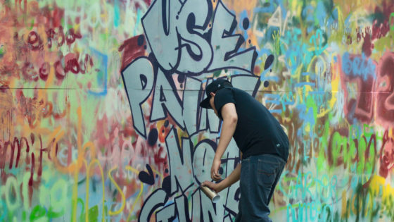 use paint not guns spray painting