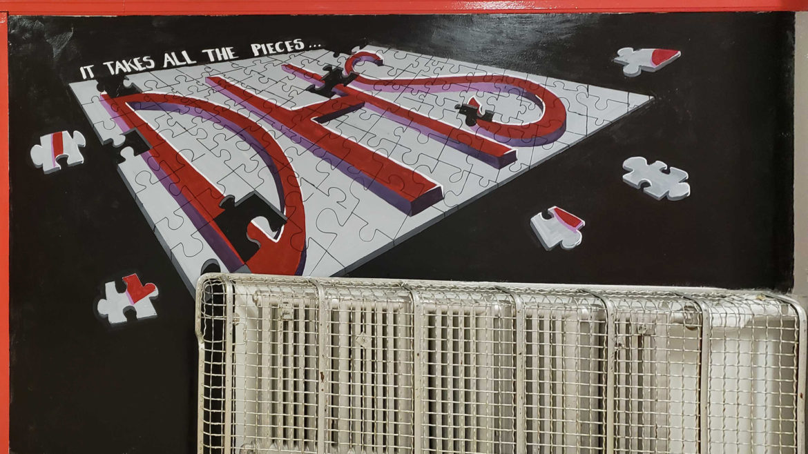 """""""It takes all the pieces"""" puzzle piece mural"""